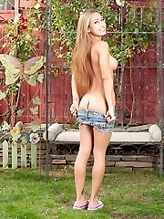 Latin teen Amia Moretti puts her gams behind her head.