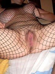 Chubby girlfriend in fishnet lingerie posing