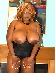 Humongous titted black babe gets boned