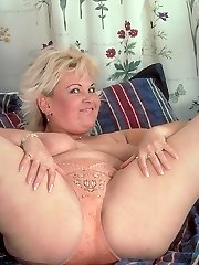 Top mighty mature ash-blonde pawing her plump bazooms and gets down on all fours to show off her ass