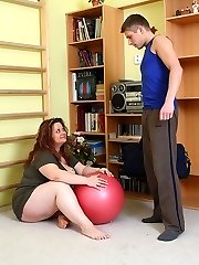 Sex-positive fat chick with gigantic natural tits fucked from behind by her horny personal trainer
