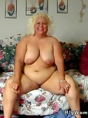 Busty mature BBW lounges about nude