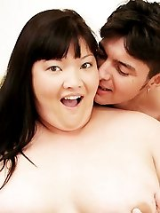 Horny Asian bbw model Olivia cramming her fat covered pussy slit with a meaty prick