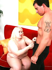 Naughty plumper Tina Rose plays with her huge fat boobs while a hunk glazes it with fresh cum