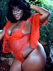 large shiny skinned exotic black woman in red