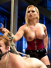 Welcome new domme Katja Kassin to Whipped Ass. Katja, a strict and sexy German dominatrix is given the adorable submissive Claire Robbins as a gift and she expects her to perform and please her to her high standards. Katja's sexy verbal humiliation and Claire's innocent smile are infectious and together it's all hot and strict lesbian BDSM at it's finest. OTK spanking, caning, dildo gag, rope bondage, and strap-on ass fucking are all included.