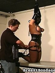 Masked and corseted - a ache slut is introduce to tit bondage.