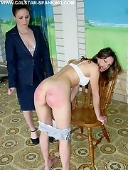 Brutal Mistress is spanking and caning 2 hot young Beauties