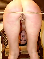 Two young lovelies spanked and caned on their pert obese asses