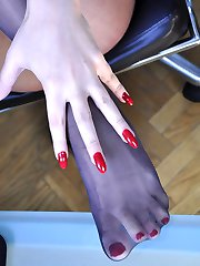 Smoking hot office girl slips out of her heels to caress her nyloned feet