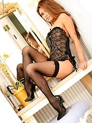 Sexy Asian porn star Charmaine Star looks fantastic in stockings and heels in this sexy foot...