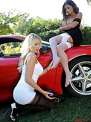 Leggy beauties rock the car!