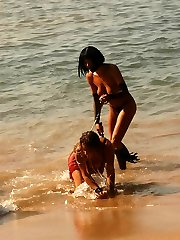 Mistress walks her sexy slave along the surf line, makes her crawl and strapon-fucks her dirty