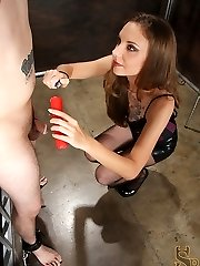 With his cock and nut tired to a bondage bed, Mistress Mona pours super-steamy wax all over them.  She continues her gimp's torment with a wartenberg wheel and by caning his beef whistle.  For his prize she allows him to jerk off in front of her, the only problem is, his cock and balls are to sore for him to cum.