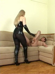 Fat-ass dominatrix in black pantyhose lets a young guy ride her big strapon