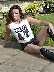 Strapon Jane shows off her attitude wearing a big black strapon, slutty knee high leather boots and a