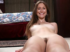 Natural coed Lilith Black spreads her hairy pussy.