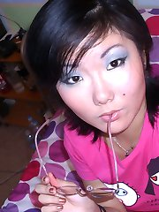 Nice Asian babe raise shirt to show her tits before her fingers caress her pussy