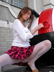 Cute girl in pleated skirt and white hose teasingly flashing nyloned pussy