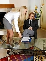 Lustful secretary babes petting each other without putting off their tights