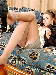 Sultry babe peels off her business suit showing her feet in silky pantyhose