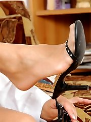 Pantyhosed chick fitting on various high heel shoes before hot selfsucking