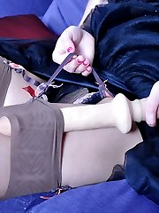 Nasty girl encased in brown gartered nylons puts to use her hidden sex toy