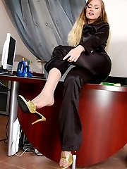 Doll-faced babe pulling down her trousers flashing her shiny striped nylons