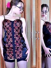 Sheepish girl in sheer black nylons secretly tries on her friends corset