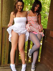 Jodie Gasson and her sister, Kelly, strip out of their dresses, in the sunshine.