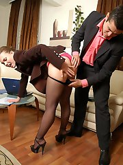 Female co-worker in lacy pantyhose ready for overtime work jumping on cock