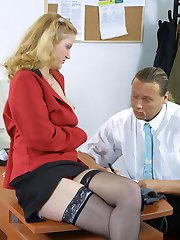 Bored secretary masturbates at her desk