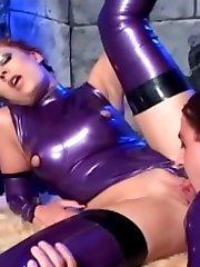 Redhead in latex stockings fucks in a dungeon