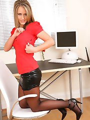 Candice looks fantastic dressed as a secretary in a red top and a black leather skirt.