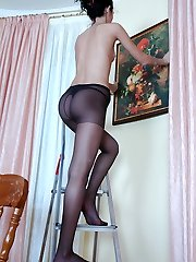 Handsome damsel readily kneading her nyloned feet after a hard working day