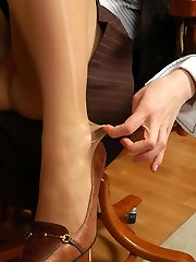 Kinky secretary in velvety pantyhose having joy while playing with her soles