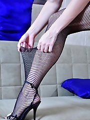 Platinum blond changes into her raunchy fishnets after a sport lesson