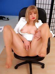 Blonde at office in secretarty dress and pantyhose