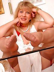 Angel at office in tender light brown stockings