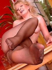 Angel in chocolate-colored sheer and shiny pantyhose