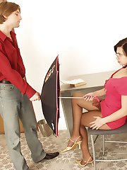 Lustful brunette playing with umbrella before getting her nylons creamed