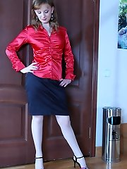 Curious maid in white tights trying on a super-sexy red blouse and a dark skirt