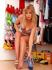 Angel at wardrobe in sheer brown stocking