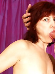 Firey redheaded older lady takes in hard!