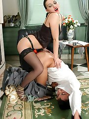 Lustful chick jamming strap-on up her barmans ass right by the fire-place