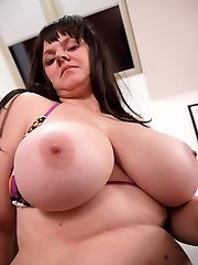 Faith Bloom having fun toying with melons and multiple bras