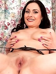 Sophia stripping down to her sheer black top ff nylons!