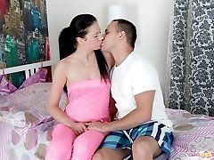 Olga is a sexy brunette, and is with her man. He moves in on her and slowly lifts off her pink...
