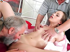 This babe is young and hot and in this scene you will watch her fuck two men who are at least...