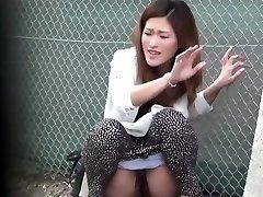 Oriental bi-atch urinate public